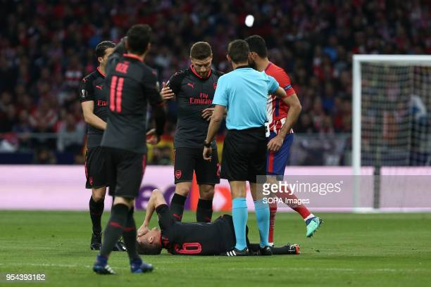 METROPOLITANO MADRID SPAIN Laurent Koscielny injures during the UEFA Europa League Semi Final Second Leg match between Atletico de Madrid and Arsenal...