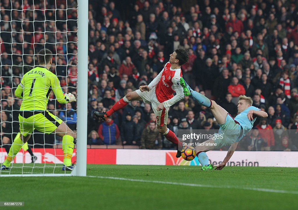 Laurent Koscielny is kicked in the face by Burnley defender Ben Mee for the Arsenal penalty during the Premier League match between Arsenal and Burnley at Emirates Stadium on January 22, 2017 in London, England.