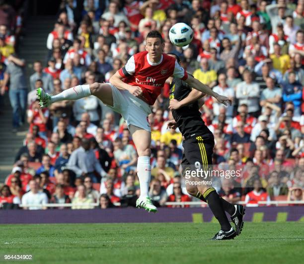 Laurent Koscielny of Arsenal and Andy Carroll of Liverpool in action during the Barclays Premier League match between Arsenal and Liverpool at the...