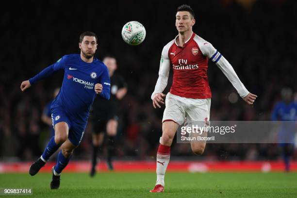 Laurent Koscielny of Arsenal and Eden Hazard of Chelsea chase the ball during the Carabao Cup SemiFinal Second Leg at Emirates Stadium on January 24...