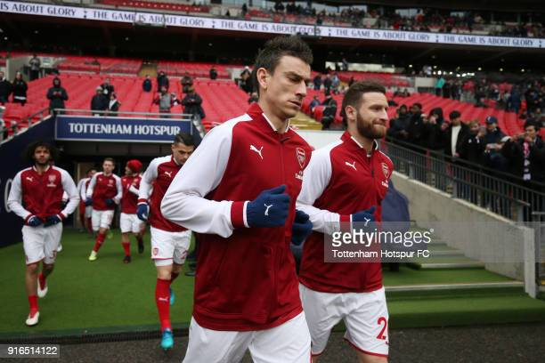 Laurent Koscielny of Arsenal and Shkodran Mustafi of Arsenal walk out to warm up prior to the Premier League match between Tottenham Hotspur and...
