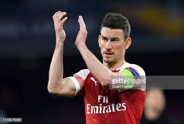 Laurent Koscielny of Arsenal applauds fans during the UEFA Europa League Quarter Final Second Leg match between SSC Napoli and Arsenal at Stadio San...