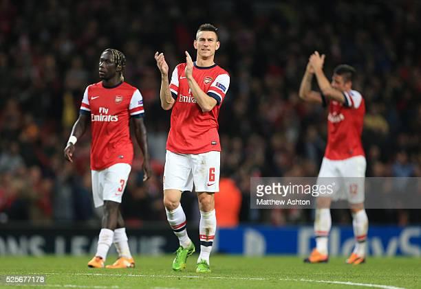 Laurent Koscielny of Arsenal applauds the fans as he walks alongside Bacary Sagna of Arsenal
