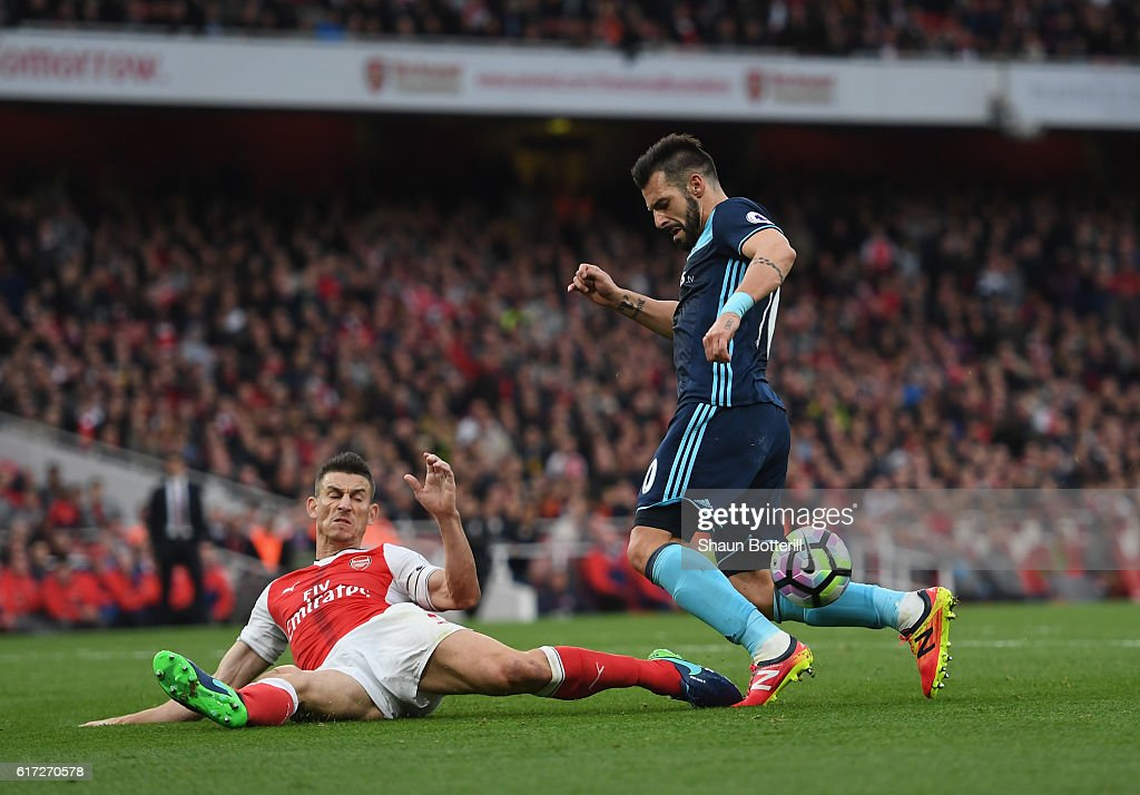 Laurent Koscielny of Arsenal (L) attempts to block Alvaro Negredo of Middlesbrough (R) shot during the Premier League match between Arsenal and Middlesbrough at Emirates Stadium on October 22, 2016 in London, England.
