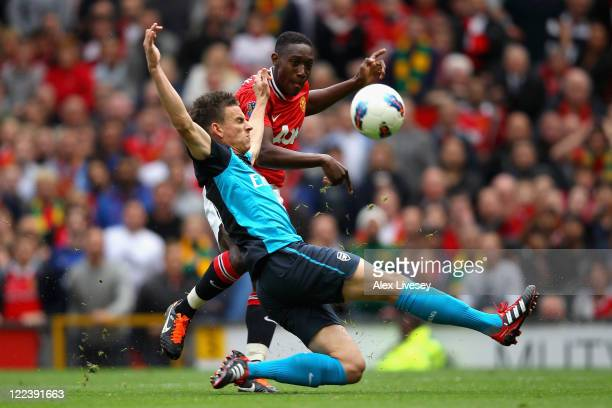 Laurent Koscielny of Arsenal attempts to block the shot by Danny Welbeck of Manchester United during the Barclays Premier League match between...