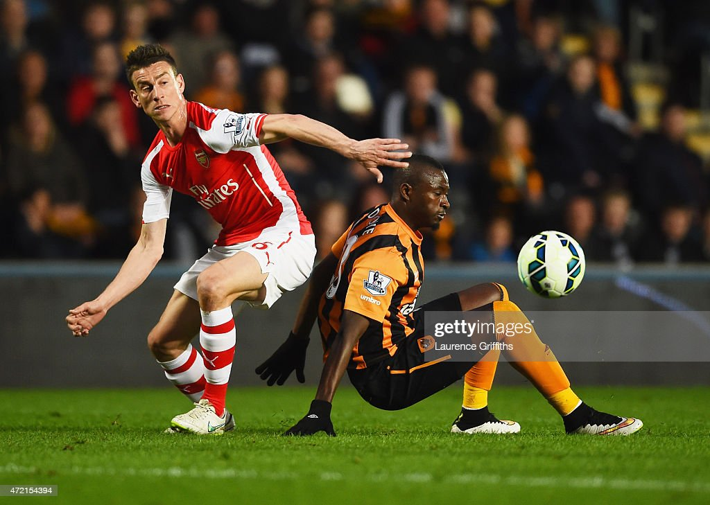 Laurent Koscielny of Arsenal battles with Dame N'Doye of Hull City during the Barclays Premier League match between Hull City and Arsenal at KC Stadium on May 4, 2015 in Hull, England.