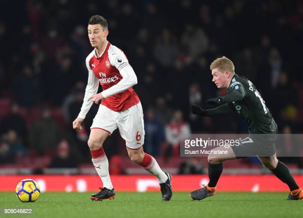 Laurent Koscielny of Arsenal breaks past Kevin De Bruyne of Man City during the Premier League match between Arsenal and Manchester City at Emirates...