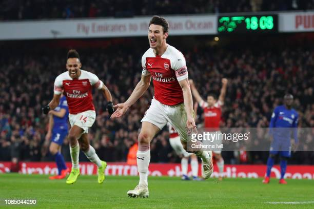 Laurent Koscielny of Arsenal celebrates after scoring his sides second goal during the Premier League match between Arsenal FC and Chelsea FC at...