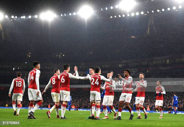 Laurent Koscielny of Arsenal celebrates after scoring his sides second goal with teammates during the Premier League match between Arsenal and...