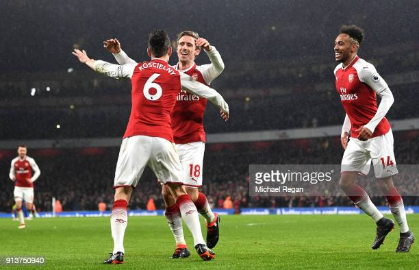 Laurent Koscielny of Arsenal celebrates after scoring his sides second goal with teammate Nacho Monreal of Arsenal during the Premier League match...