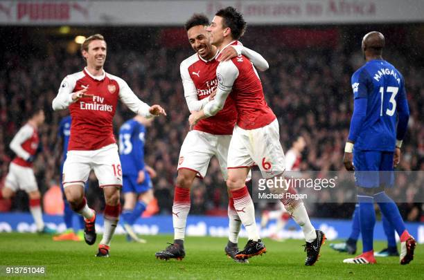 Laurent Koscielny of Arsenal celebrates after scoring his sides second goal with PierreEmerick Aubameyang of Arsenal during the Premier League match...