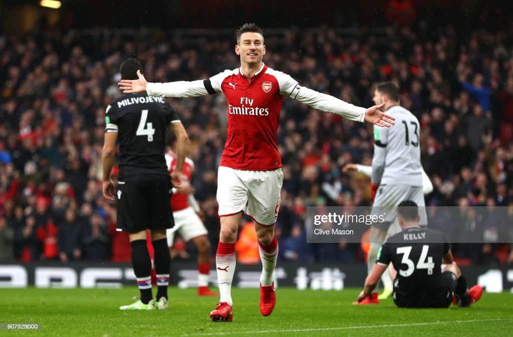 Laurent Koscielny of Arsenal celebrates after scoring his sides third goal during the Premier League match between Arsenal and Crystal Palace at Emirates Stadium on January 20, 2018 in London, England.