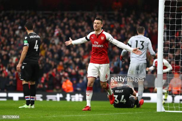Laurent Koscielny of Arsenal celebrates after scoring his sides third goal during the Premier League match between Arsenal and Crystal Palace at...