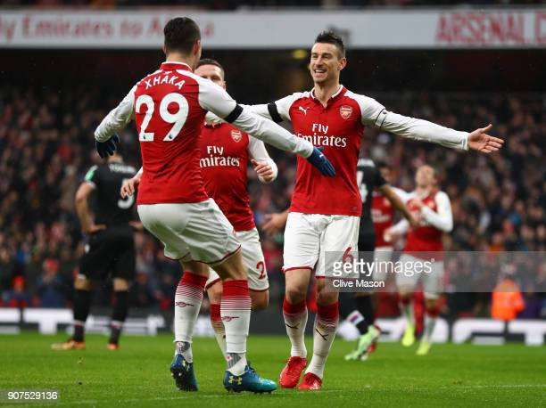 Laurent Koscielny of Arsenal celebrates after scoring his sides third goal with Granit Xhaka of Arsenal during the Premier League match between...