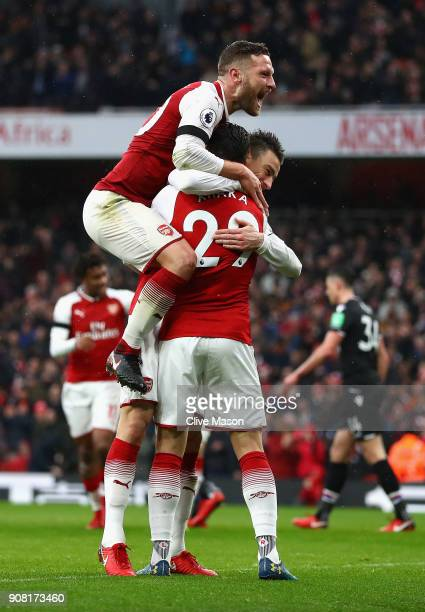 Laurent Koscielny of Arsenal celebrates after scoring his sides third goal with Granit Xhaka of Arsenal and Shkodran Mustafi of Arsenal during the...