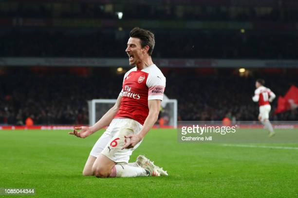 Laurent Koscielny of Arsenal celebrates after scoring his team's second goal during the Premier League match between Arsenal FC and Chelsea FC at...