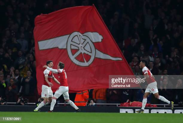 Laurent Koscielny of Arsenal celebrates after scoring his team's third goal during the Premier League match between Arsenal FC and AFC Bournemouth at...
