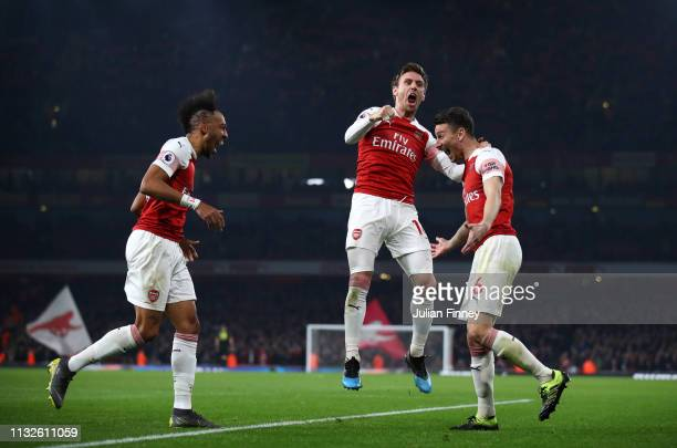 Laurent Koscielny of Arsenal celebrates after scoring his team's third goal with Nacho Monreal of Arsenal and Pierre-Emerick Aubameyang of Arsenal...