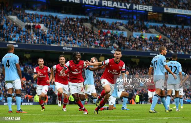 Laurent Koscielny of Arsenal celebrates after scoring their first goal during the Barclays Premier League match between Manchester City and Arsenal...