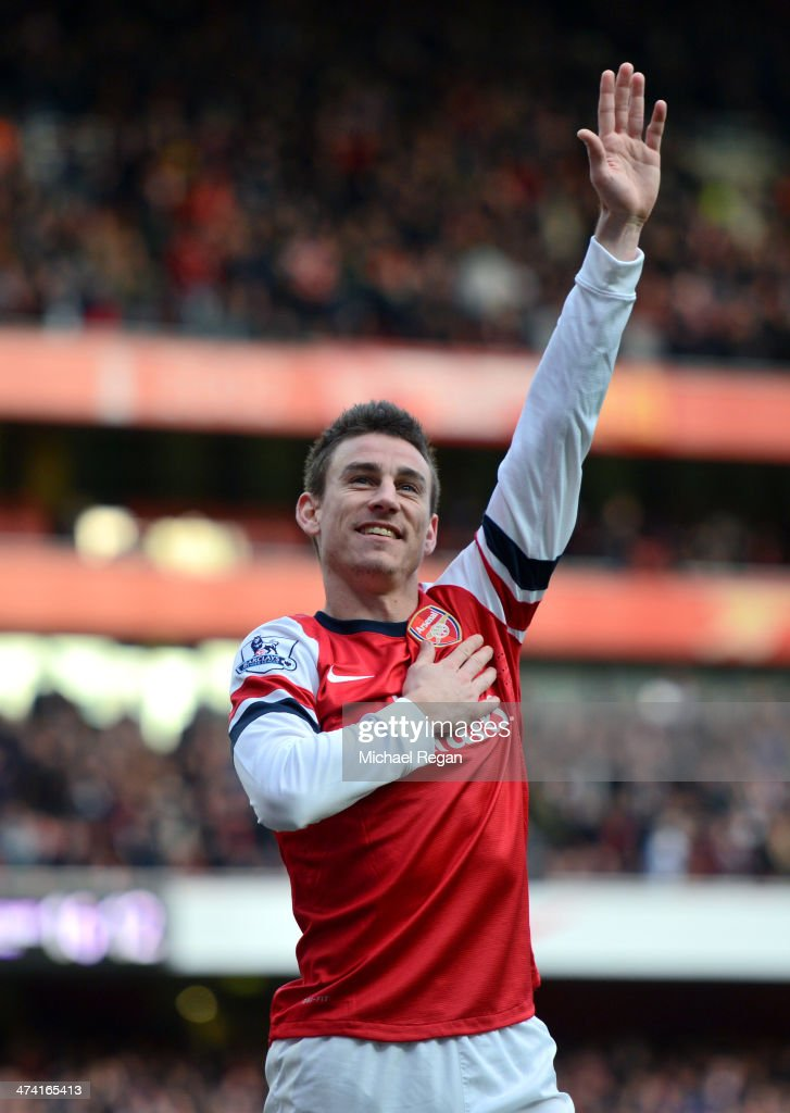 Laurent Koscielny of Arsenal celebrates after scoring their third goal during the Barclays Premier League match between Arsenal and Sunderland at Emirates Stadium on February 22, 2014 in London, England.