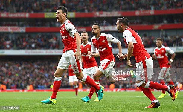 Laurent Koscielny of Arsenal celebrates scoring his sides first goal with his team mates during the Premier League match between Arsenal and...