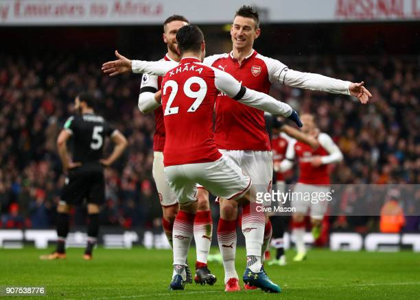 Laurent Koscielny of Arsenal celebrates scoring his side's third goalwith Granit Xhaka during the Premier League match between Arsenal and Crystal...