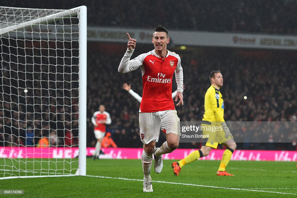 Laurent Koscielny of Arsenal celebrates scoring his team's first goal during the Barclays Premier League match between Arsenal and Newcastle United at Emirates Stadium on January 2, 2016 in London, England.