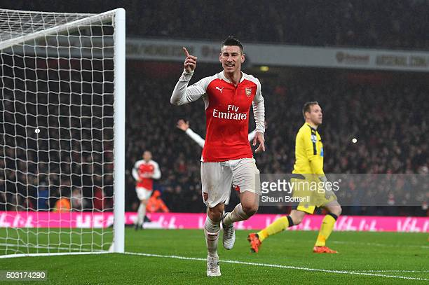 Laurent Koscielny of Arsenal celebrates scoring his team's first goal during the Barclays Premier League match between Arsenal and Newcastle United...