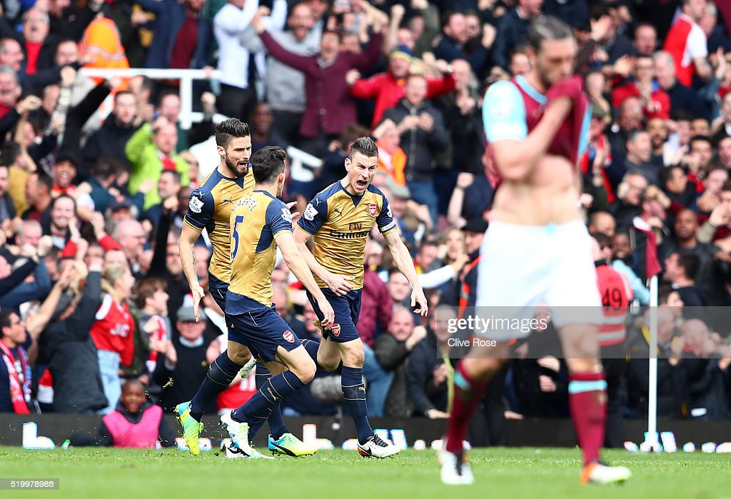Laurent Koscielny (3rd L) of Arsenal celebrates scoring his team's third goal with his team mates Olivier Giroud (1st L) and Gabriel (2nd L) during the Barclays Premier League match between West Ham United and Arsenal at the Boleyn Ground on April 9, 2016 in London, England.