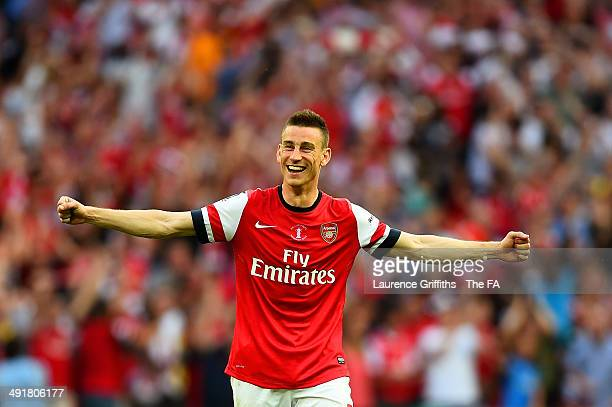Laurent Koscielny of Arsenal celebrates victory after the FA Cup with Budweiser Final match between Arsenal and Hull City at Wembley Stadium on May...