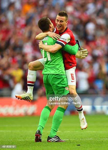 Laurent Koscielny of Arsenal celebrates victory with Lukasz Fabianski of Arsenal after the FA Cup with Budweiser Final match between Arsenal and Hull...