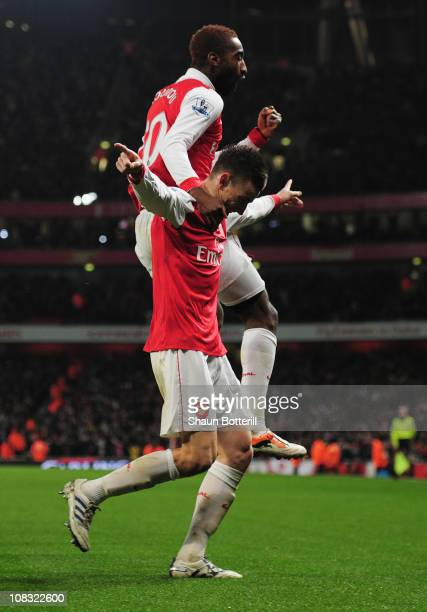 Laurent Koscielny of Arsenal celebrates with Johan Djourou as he scores their second goal during the Carling Cup Semi Final Second Leg match between...