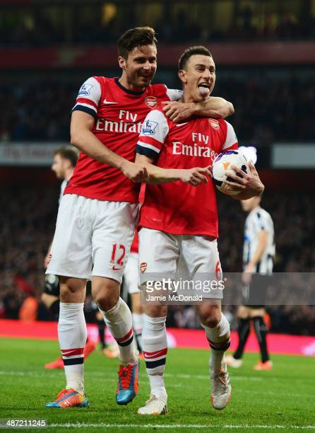 Laurent Koscielny of Arsenal celebrates wth Olivier Giroud as he scores their first goal during the Barclays Premier League match between Arsenal and...