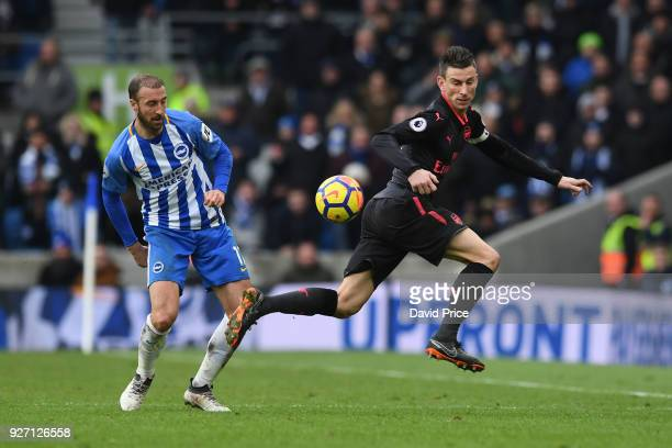 Laurent Koscielny of Arsenal challenged by Glenn Murray of Brighton during the Premier League match between Brighton and Hove Albion and Arsenal at...