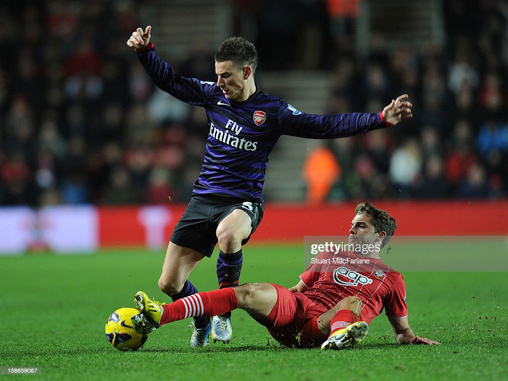 Laurent Koscielny of Arsenal challenged by Jay Rodriguez of Southampton during the Barclays Premier League match between Southampton and Arsenal at St Mary's Stadium on January 01, 2013 in Southampton, England.