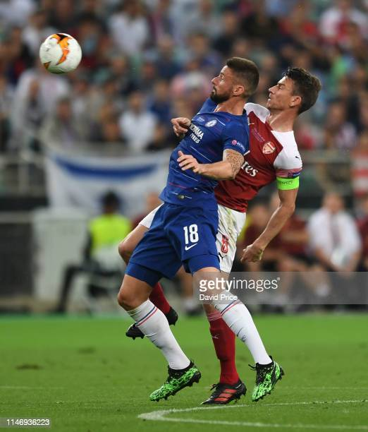 Laurent Koscielny of Arsenal challenges Olivier Giroud of Chelsea during the UEFA Europa League Final between Chelsea and Arsenal at Baku Olimpiya...