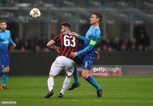 Laurent Koscielny of Arsenal challenges Patrick Cutrone of Milan during UEFA Europa League Round of 16 match between AC Milan and Arsenal at the San...
