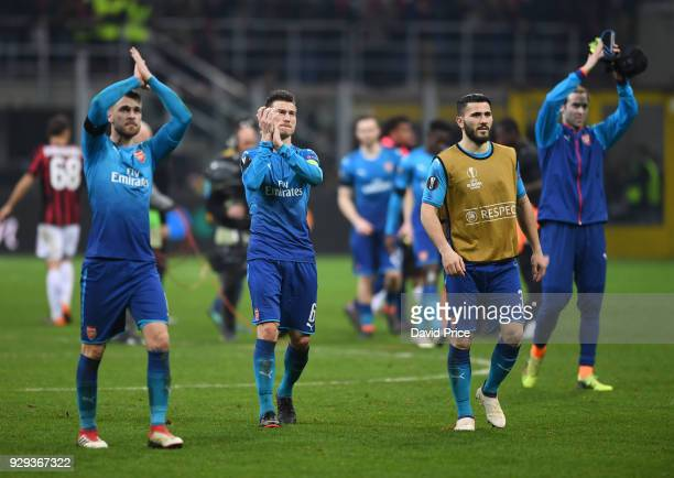 Laurent Koscielny of Arsenal claps the fans after UEFA Europa League Round of 16 match between AC Milan and Arsenal at the San Siro on March 8 2018...