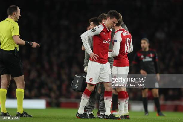 Laurent Koscielny of Arsenal comes off injured early in the game being replaced by Calum Chambers of Arsenal during the UEFA Europa League Round of...