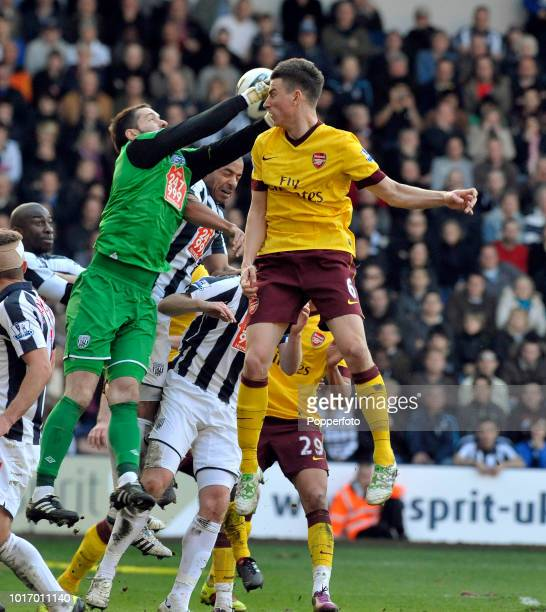 Laurent Koscielny of Arsenal competes with West Bromwich Albion goalkeeper Scott Carson during the Barclays Premier League match between West...