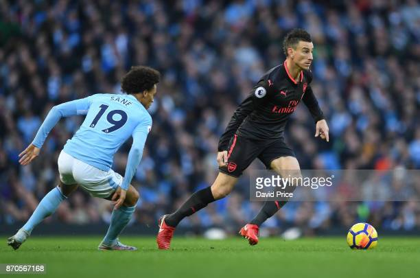 Laurent Koscielny of Arsenal cuts inside Leroy Sane of Man City during the Premier League match between Manchester City and Arsenal at Etihad Stadium...