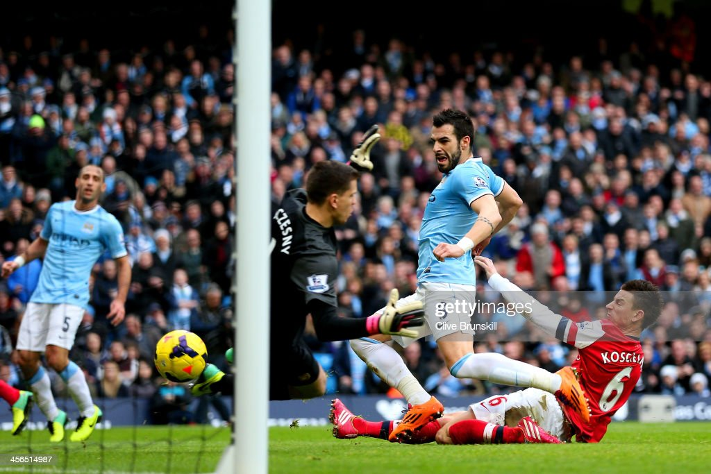 Laurent Koscielny of Arsenal fails to stop Alvaro Negredo of Manchester City scoring their second goal during the Barclays Premier League match between Manchester City and Arsenal at Etihad Stadium on December 14, 2013 in Manchester, England.