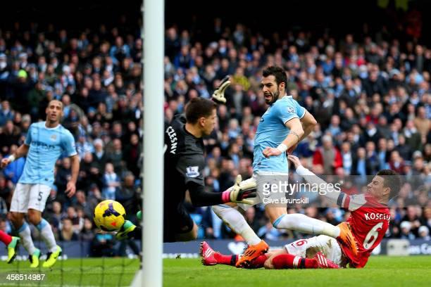 Laurent Koscielny of Arsenal fails to stop Alvaro Negredo of Manchester City scoring their second goal during the Barclays Premier League match...