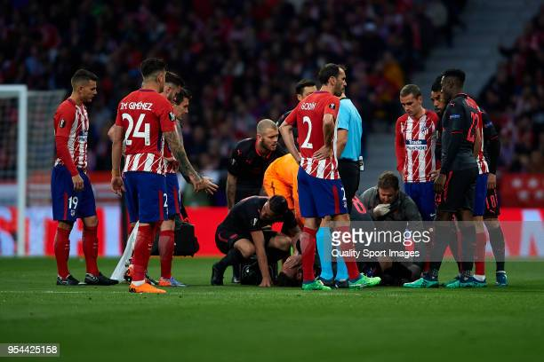 Laurent Koscielny of Arsenal FC lies injured on the pitch during the UEFA Europa League Semi Final second leg match between Atletico Madrid and...