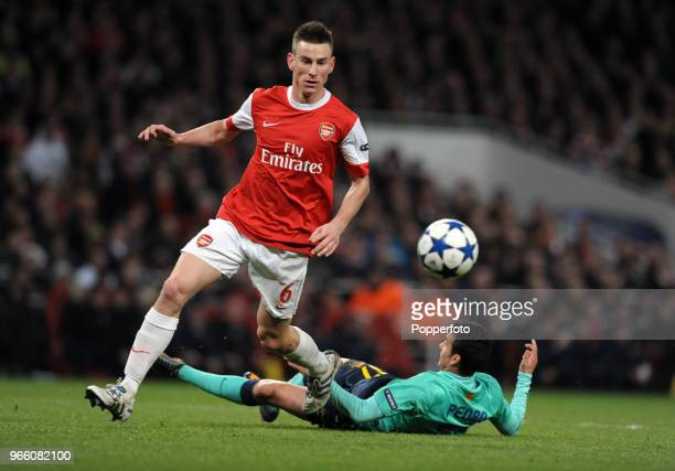 Laurent Koscielny of Arsenal fouls Barcelona's Pedro Rodriguez during the UEFA Champions League round of 16 first leg match between Arsenal and...