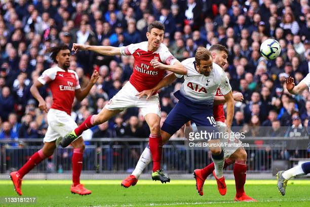Laurent Koscielny of Arsenal fouls Harry Kane of Tottenham Hotspur and a penalty is awarded during the Premier League match between Tottenham Hotspur...