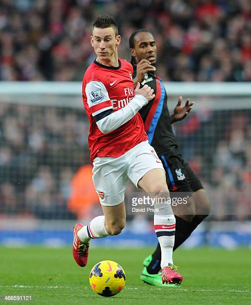 Laurent Koscielny of Arsenal gets to the ball ahead of Cameron Jerome of Stoke during the match between Arsenal and Crystal Palace in the Barclays...