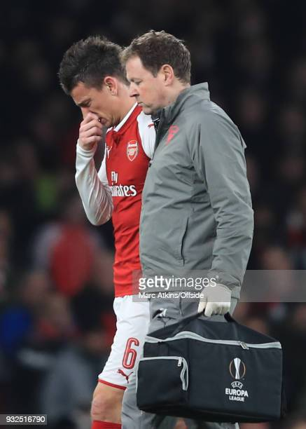Laurent Koscielny of Arsenal goes off injured during the UEFA Europa League Round of 16 2nd leg match between Arsenal and AC MIian at Emirates...