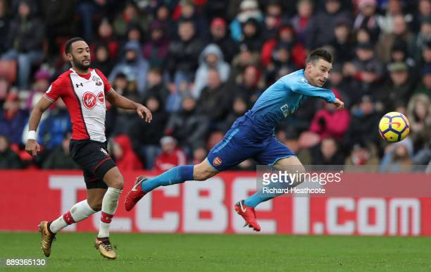 Laurent Koscielny of Arsenal heads the ball away from Nathan Redmond of Southampton during the Premier League match between Southampton and Arsenal...
