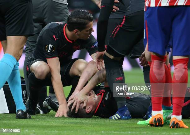 Laurent Koscielny of Arsenal here recomforted by Granit Xhaka of Arsenal is seriously injured during the UEFA Europa League Semi Final second leg...